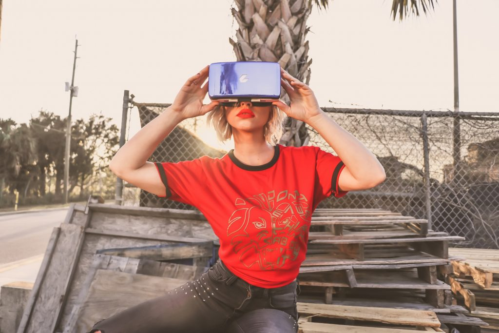 woman-in-red-crew-neck-t-shirt-wearing-virtual-reality-911601